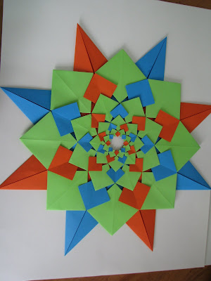 Tomoko Fuse's Origami Quilt Blooming Flowers 1 in Orange, Green, and Blue