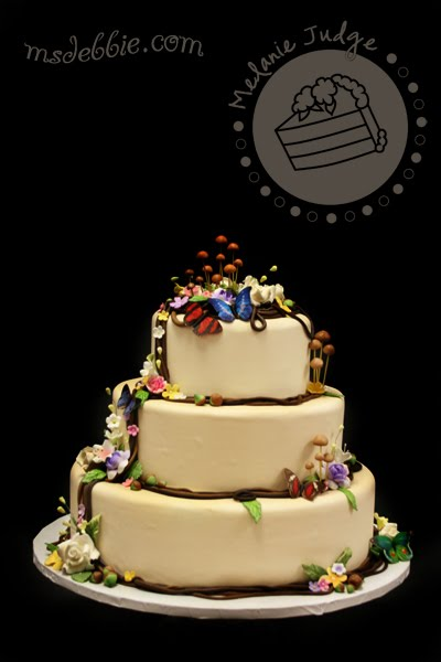 woodsy wedding cake mushroooms acorns butterflies vines