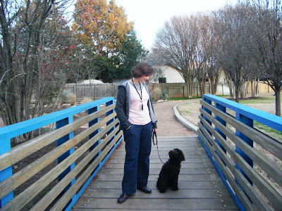 Alfie and me on a footbridge; he's sitting looking up at me