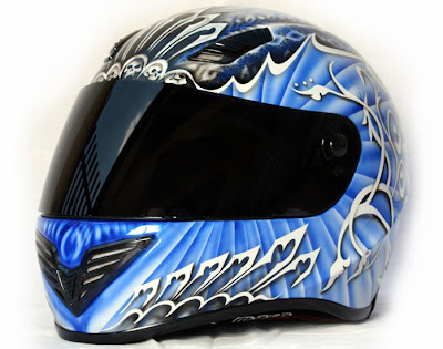 Blue skull airbrushed designs on sport helmet 1