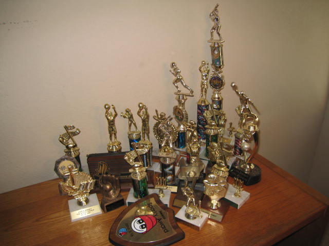 As I slowly gather up a few of my adult children trophies from all of their ...