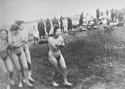 A group of naked Jewish women and girls walk to the execution site on the ...