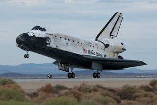 Space shuttle Discovery lands at Edwards Air Force Base
