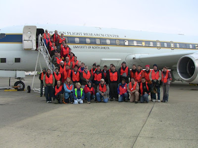 Crew and researchers gathered in front of the DC-8