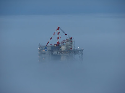 The A-2 Test Stand peered out from a thick blanket of fog during the early morning hours of Oct. 28, 2009. This photo was taken from the top of the B Test Stand