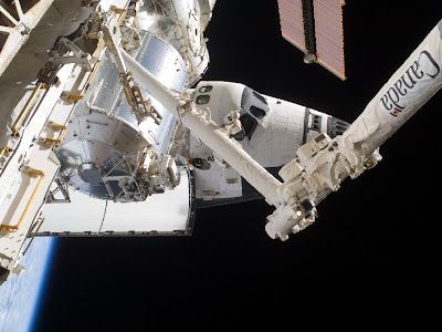 A partial view of the space shuttle Atlantis docked to the International Space Station
