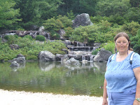 The water falls in this gorgeous Japanese gardens was built from green serpentine rock and coy fish swam in the waters.... very serene and lovely