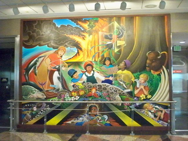This Is Mural Number One. It Depicts Two Dead Women And One Young Girl  Laying In Caskets. A Fire In The Back Ground Engulfing Everything. Part 67