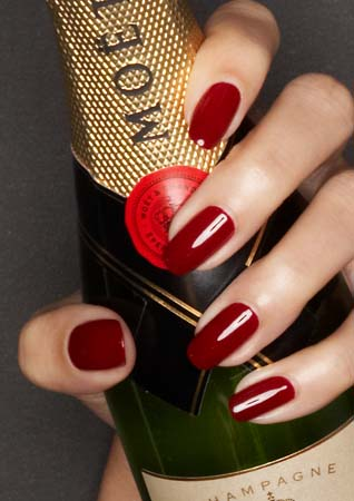Red nails and Champagne Fridays... We could get on board with that Holyday Manicure