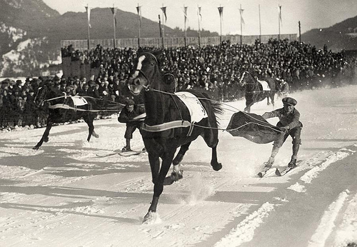 """""""Skijoring"""": people on skis pulled by a horse, dogs or a motor vehicle. Location unknown, 1930. Nationaal Archief / Spaarnestad Photo"""