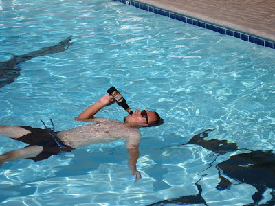 drinking beer in a swimming pool