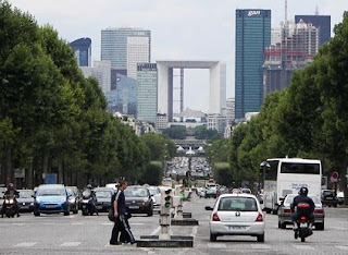 Rush hour in Paris is dominated by small cars and motorcycles.