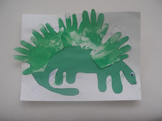 I really liked this idea to make a stegosaurus and using hand prints to make the dorsal plates. & Stegosaurus Hand Print Craft | Preschool Crafts for Kids