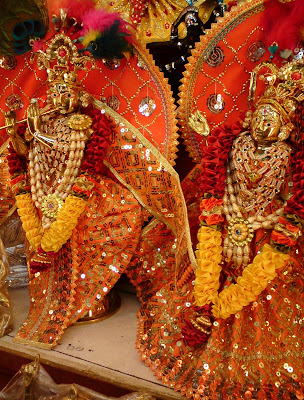 Beautifully decorated idol of Lord Krishna with His beloved, Radharani