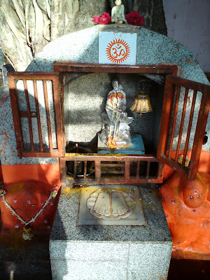 A small idol of Sai Baba just beneath the Banyan tree in the Khandoba Temple premises