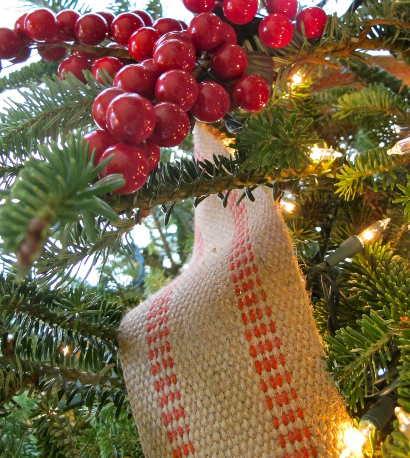 some of the details are frosted red balls the great lantern from my aunts shop red berries and burlap strapped