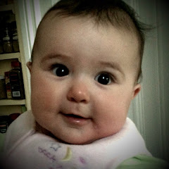 Esme at six months -- Note Daddy's twinkling eyes...