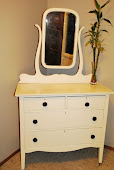Antique dresser with swing mirror