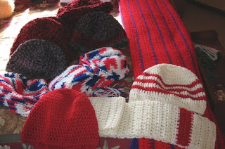 crocheted scarf and hats