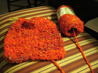 knitted bright and lofty scarf on the needles