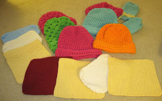 squares, hats, and mittens for homeless