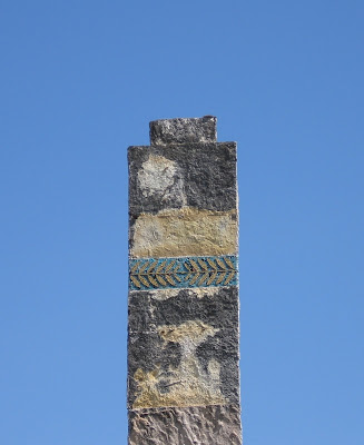 old chimney with worn out decoration