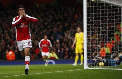 Arsenal striker Eduardo celebrates his goal against Cardiff City