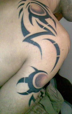 Tribal Tattoos Design on The Arm and Back