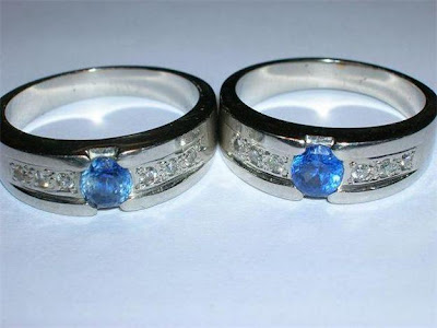 The ladies ring is generally a diamond wedding ring matching blue sapphire
