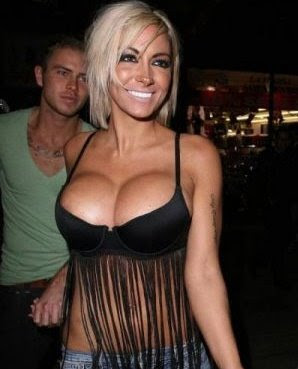Jodie Marsh showing off cleavage and nipple