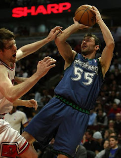 Minnesota Timberwolves #55 taking a jump Shot