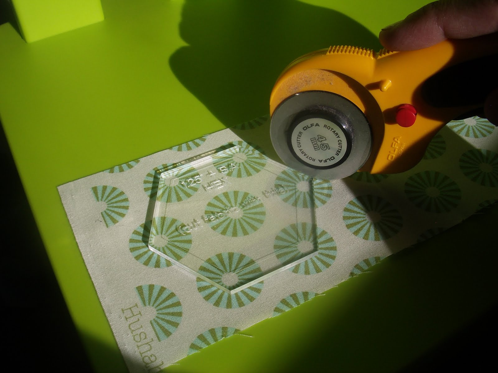 Made on main street hexagon english paper piecing tutorial dont have a plastic template cut one out of paper and use it as a guide to draw a hex on your fabric then cut using your ruler as a guide maxwellsz