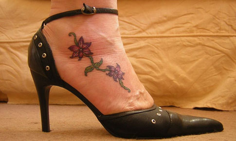 Here's another feminine tattoo Designs flower on foot, this time on the side