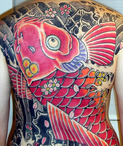 Gold koi fish tattoo swimming