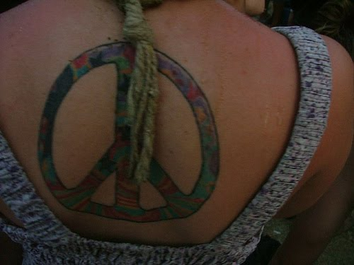 peace sign and flowers tattoo designs