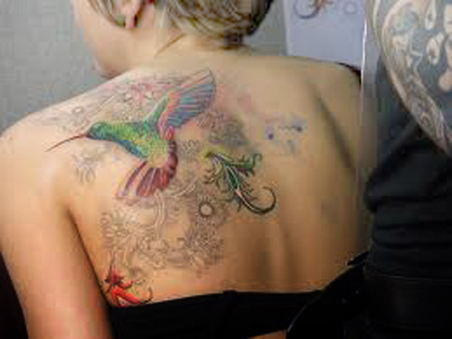 World tattoos design beautiful hummingbird tattoo designs for Beautiful design tattoos