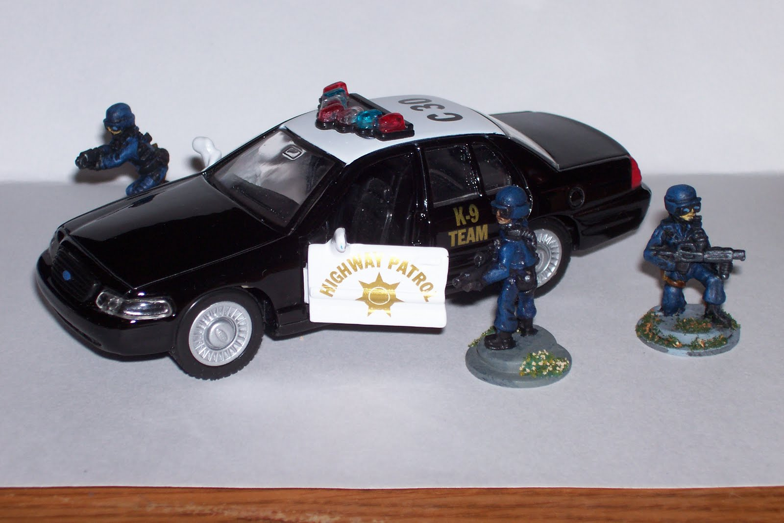 Toy Swat Trucks http://combatstormplayer.blogspot.com/2010/04/police-car-for-28mm.html