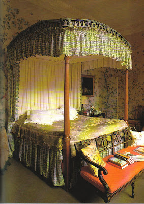 A classic treatment of jib doors- papering both the walls and the door (located to the right of the bed). Design by John Fowler (Sudeley Castle.) & The Peak of Chic®: The Mysterious Jib Door