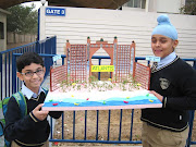 . his classmate holding up their class project ' The Atlantis , Dubai' . (img )
