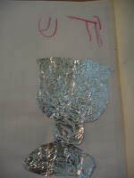 "foil cut-out of wine goblet for ""kadesh"""
