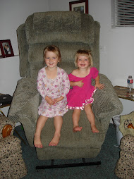 Girls enjoying Dad's new chair