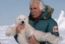 Man Holding Polar Bear Cub