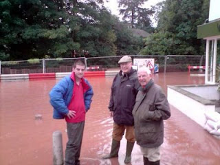 Tenbury Mayor; Cllr Jones, Cllr Morgan and Town/District Councillor Penn take a break in their sandbag distribution to survey the damage.