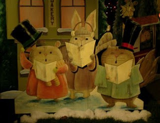 Mouse, rabbit, and cat caroling
