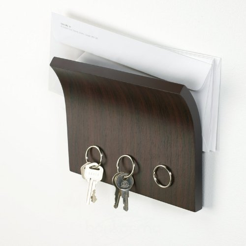 Mount these ceramic hooks to the wall, and immediately have a place to hang  your coat with a small