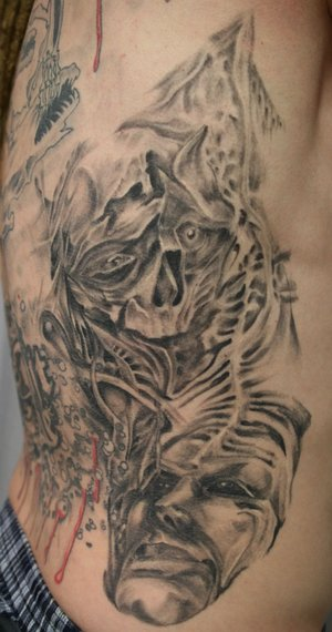 rib cage tattoos. Face Skull Rib Tattoo Design