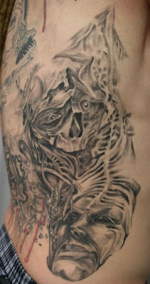 Face Skull Rib Tattoo Designs