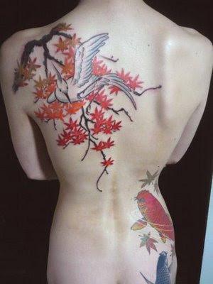 Half-sleeve tattoo of a Japanese geisha tattoo holding a fan.