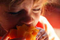 Toddler Eating a Peach