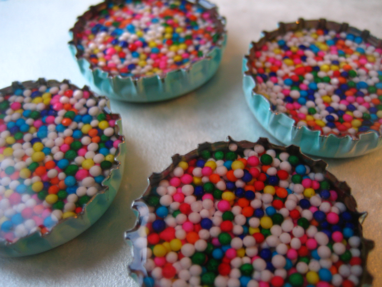 Flint handmade birth of a craft resin bottle cap magnets for Crafts to do with bottle caps